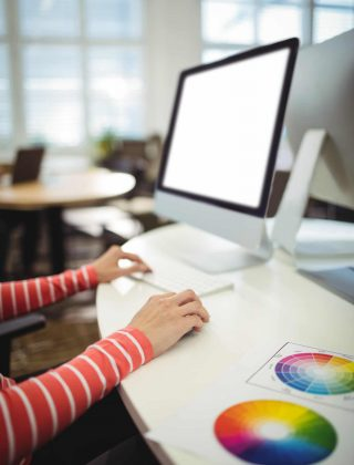 Graphic designer working at her desk in the office